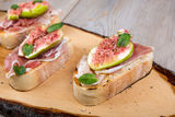 Crostini with fresh fig, peppermint and prosciutto ham Royalty Free Stock Photography