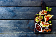 Crostini with fruits Stock Images