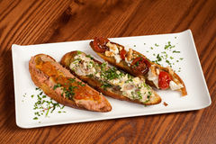 Crostini on a garnished plate Stock Image
