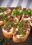 Crostini with goat cheese and Beluga lentils Royalty Free Stock Photos