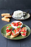 Crostini with goat cheese and strawberry Stock Photos