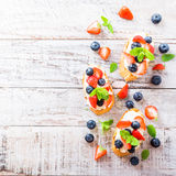 Crostini with grilled baguette, cream cheese and berries stock photography