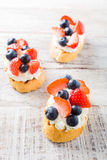 Crostini with grilled baguette, cream cheese and berries Stock Photos