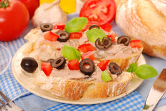 Crostini with pate and olives Stock Photos