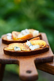 Crostini with Peaches and Blue Cheese Royalty Free Stock Photos