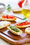 Crostini with Pesto, Cheese,and Tomato Royalty Free Stock Image
