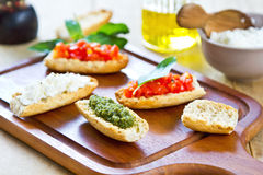 Crostini with Pesto, Cheese,and Tomato Stock Photos