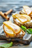 Crostini with ricotta and caramelized pear. Royalty Free Stock Photography