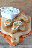 Crostini with ricotta chese and smoked salmon Royalty Free Stock Photos