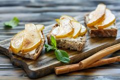 Homemade bread with seeds, ricotta and pear. Stock Photography