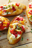 Crostini with roasted bell pepper, goat cheese, garlic and herbs Stock Images