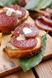 Crostini with salami. And cheese stock image