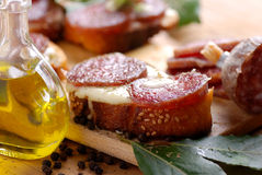 Crostini with salami. And cheese royalty free stock image