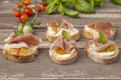Crostini. Small sandwiches with goat cheese, prosciutto  and chutney Stock Photos