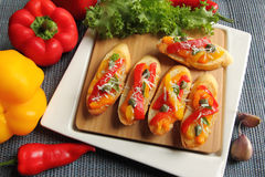 Crostini. Small toasts with colored peppers and spices Stock Photo
