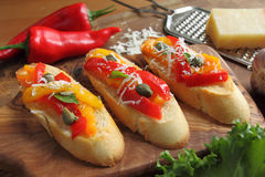Crostini. Small toasts with colored peppers and spices Stock Photos