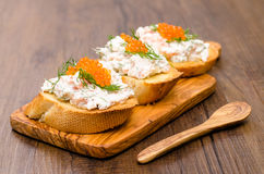 Crostini with smoked salmon and trout caviar Royalty Free Stock Photos