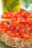 Crostini with tomato. Close up of italian crostini with tomato and oil Royalty Free Stock Photo