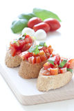 Crostini with tomato, basil and garlic Stock Photography