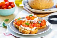 Crostini. Tomato and Cottage cheese crostini Stock Photos