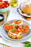 Crostini. Tomato and Cottage cheese crostini Royalty Free Stock Image