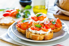Crostini. Tomato and Cottage cheese crostini Royalty Free Stock Images