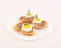 Crostini topped with tuna cream. Boilded eggs, black pepper and dill Stock Photography
