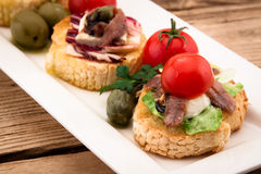 Crostini vith mozzarella cheese Royalty Free Stock Image