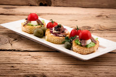 Crostini vith mozzarella cheese Stock Images