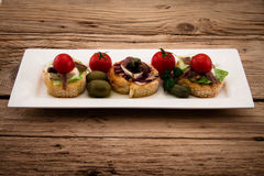 Crostini vith mozzarella cheese Royalty Free Stock Photos