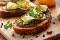 Crostini with zucchini. On the wooden table Stock Photo