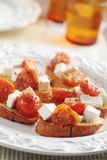 Crostinis with feta cheese and tomato Stock Images