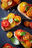 Crostinis with Fresh Cherry Tomatoes and Basil Stock Photo