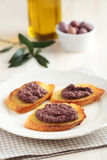 Crostinis with olive pate Stock Photography