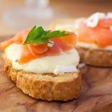 Crostinis with salmon and mozzarella Royalty Free Stock Photo
