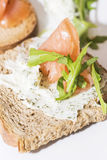 Crostinis with smoked salmon and Cheese. Toast with herb cheese, salmon and rocket stock image