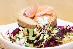 Crostinis with smoked salmon and Cheese. Toast with herb cheese, salmon and rocket stock images