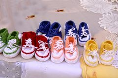 Crotchet baby shoes. Homemade crotchet baby shoes and doilies to buy n the streets of Zadar Stock Images