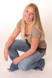 Crouching blonde teen Stock Photo