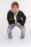 Crouching boy Stock Photography