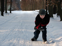 Crouching child in the winter forest Royalty Free Stock Image