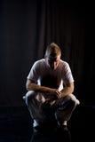 Crouching in dark Stock Photo