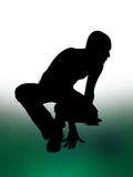 Crouching Figure. Silhouette of a man crouching on the dance floor Stock Photo