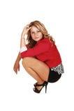 Crouching girl. Stock Image