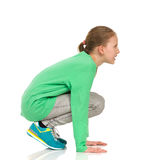 Crouching Girl Side View Royalty Free Stock Photo