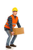 Crouching with a heavy package. Stock Photos