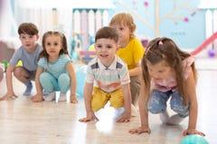 Crouching kids prepared to jump. Sport activities. Crouching children prepared to jump. Sport activities stock photo
