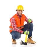 Crouching lumberjack posing Royalty Free Stock Images