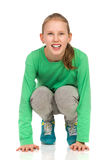 Crouching Smiling Girl Stock Image