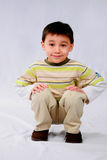 Crouching Tiger. Studio shot of cute asian boy crouching Stock Photography